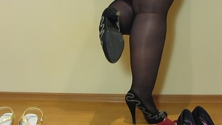 Foot fetish from beautiful bbw, cream on the feet and bloated legs in stockings in sexy high-heeled shoes.