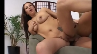 Slutty brunette Leah Lexington tit-fucks cock and gets fucked doggystyle