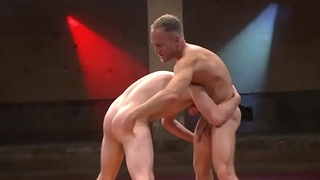 Well-muscled hunk assfucking wrestling submissive
